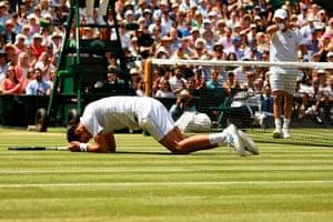 Novak Djokovic slips over.