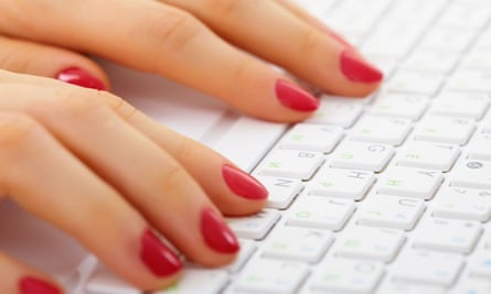 Woman's hands on a computer keyboard close up - typing