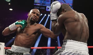 Floyd Mayweather lands a punch on Andre Berto during the fight at the MGM Grand Garden Arena in Las Vegas.