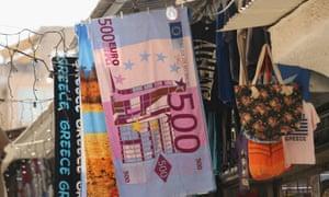 A beach towel of a €500 note at a souvenir shop in Athens, Greece