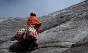 An Aymara indigenous woman practises climbing