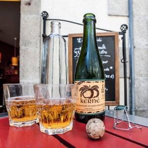 Cider bottle with glasses and a cork, Quimper, Brittany, France