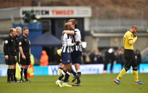 Millwall's Tony Craig and Nadjim Abdou celebrate after the whistle.