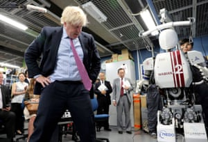 Tokyo, Japan Foreign Secretary Boris Johnson looks at a bipedal humanoid robot Wabian2 at Research Institute for Science and Engineering at Waseda University's Kikuicho Campus