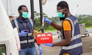 Flight operators scan a package in for delivery in Ghana amid the coronavirus outbreak in Accra, Ghana on 16 April 2020. Picture taken April 16, 2020.