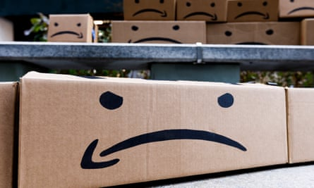 Boxes with a reimagined Amazon logo during a protest over the company opening one of two new headquarters in New York.