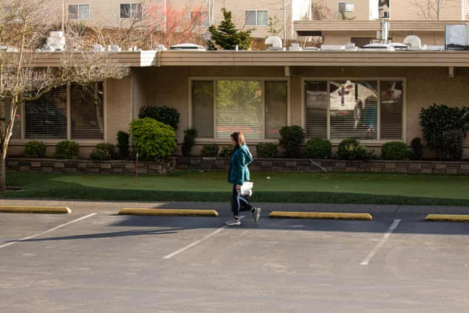 A woman leaves Life Care Center of Kirkland on February 29, 2020 in Kirkland, Washington. Dozens of staff and residents at Life Care Center of Kirkland had already started exhibiting coronavirus-like symptoms.