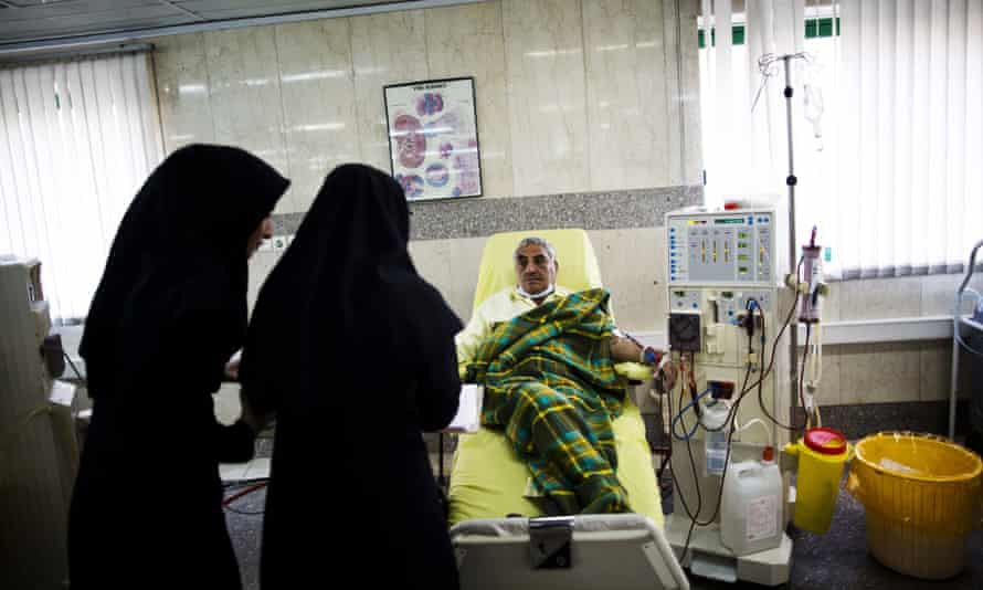 Nurses check on a patient receiving treatment at clinic in Tehran.