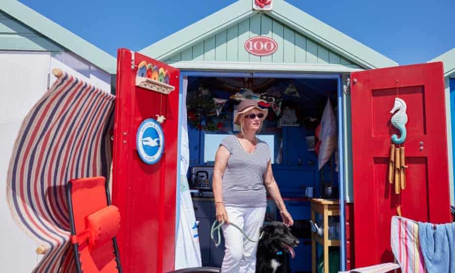 Bonny Holland with her dog in her Hove beach hut.
