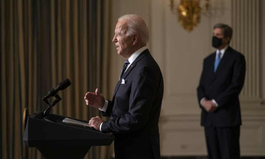 John Kerry, right, the president's climate envoy, listens as Joe Biden delivers remarks on the climate crisis shortly after taking office.
