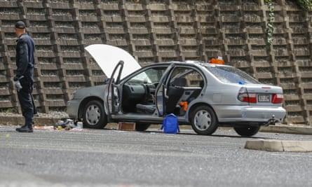 Authorities search a car at Redbank Plaza car park west of Brisbane after suspicious items were found.
