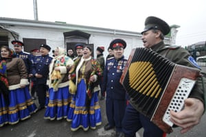 Russian Cossacks perform outside the polling station in Rostov-on-Don, Russia