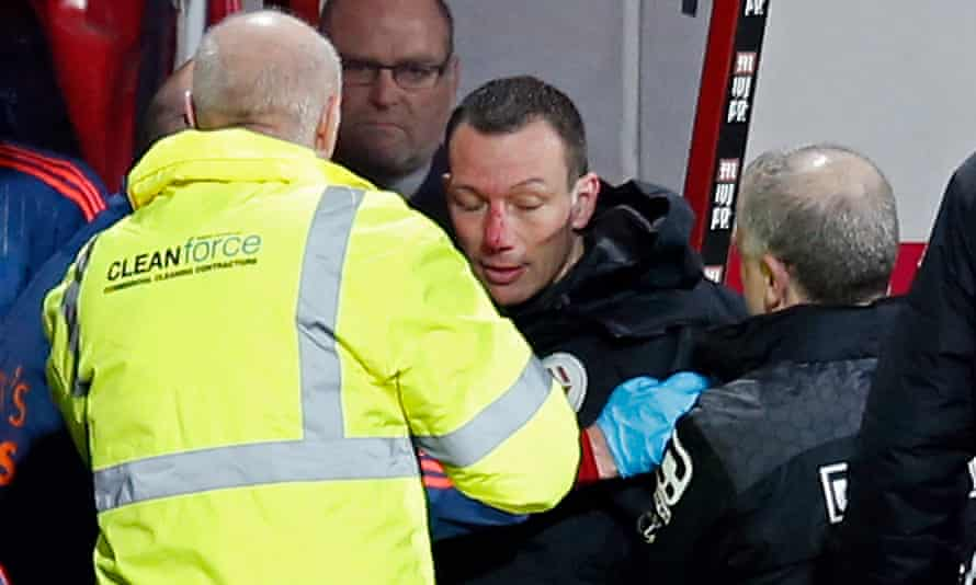 Kevin Friend receives medical attention after collapsing on to the dugout at the Vitality Stadium.