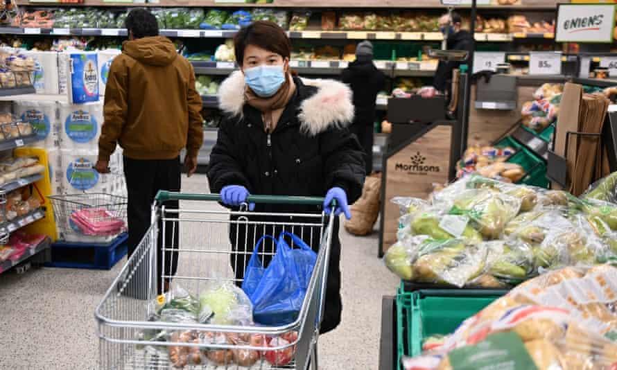 A shopper at a Morrisons supermarket