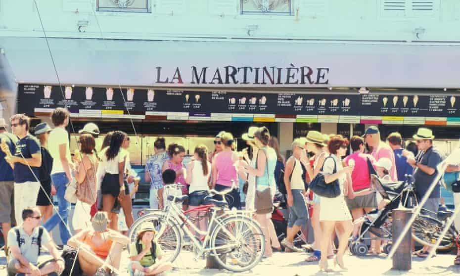 Customers outside famous ice-cream shop La Martinière, Île de Ré, France.