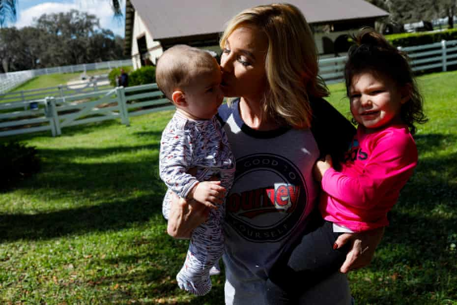 Pastor Paula White-Cain holds her granddaughter, Asher, 2, (right) while kissing her grandson Nicholas, 6 months old, at her home in Apopka, Florida on Thursday, February 28, 2019. White-Cain is a senior pastor at New Destiny Christian Center. Eve Edelheit for The Guardian