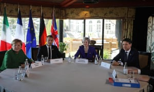 From left: German Chancellor Angela Merkel, French President Emmanuel Macron, British Prime Minister Theresa May, and Italian Prime Minister Giuseppe Conte meet at the G7 summit in La Malbaie, Quebec.