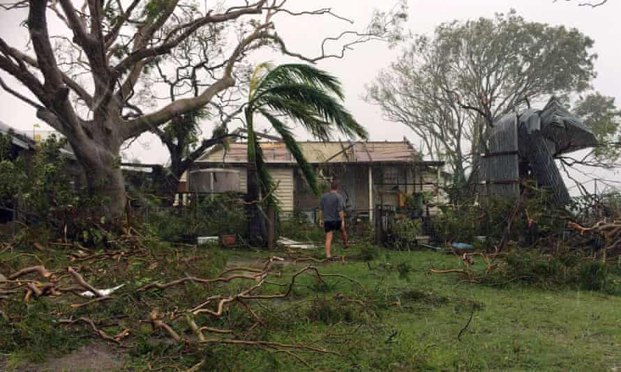 A man enters a badly damaged house after cyclone Marcia hit the coastal town of Yeppoon in north Queensland on Friday.