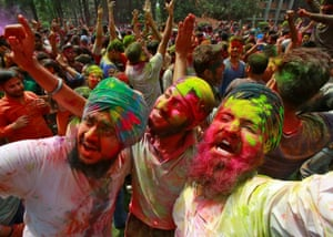 Students cheer during festivities at a university campus in Chandigarh