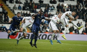 Enzo Roco of Besiktas, right, scores his side's equaliser.
