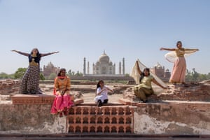 Five women who all survived acid attacks pose in front of the Taj Mahal in India