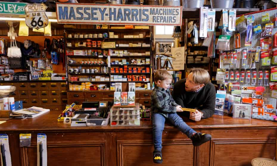 Thomas Lewis Jones with his son Arthur, the star of the ad, in Hafod Hardware store.