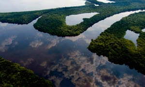 Clouds gather over the rainforest near Manaus.