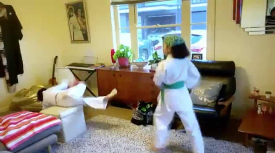 Masterchef Georgia in karate gear kicking her little brother