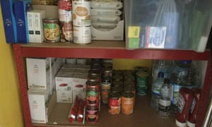 Thomas's stockpile of tinned items. He says he has also put together medicines and some DIY tools.