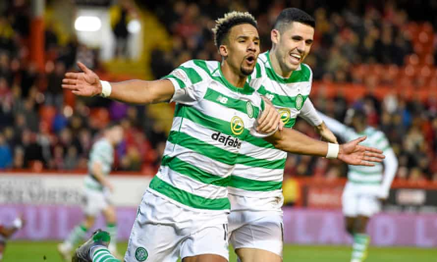 Celtic's Scott Sinclair (left) celebrates scoring one of his three goals against Aberdeen with his teammate Tom Rogic.
