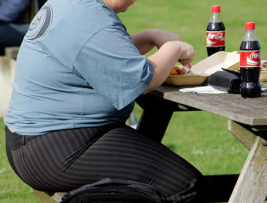 An overweight person eats, in London