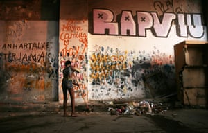 A woman sweeps in the Mangueira favela