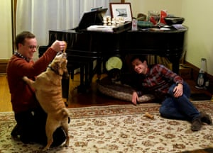 Pete Buttigieg watches as his husband Chasten plays with their dog Buddy at their home in South Bend, Indiana.
