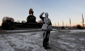 A demonstrator holds a cardboard Hitler to protest against a meeting of far-right party leaders in Koblenz, central Germany, last week.