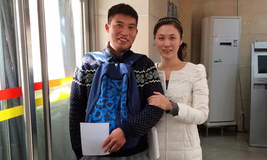 Li Ze, left, and his wife Jia Meijian hope to have two children but worry about the high cost.