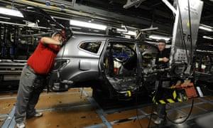 Nissan technicians work on a Qashqai car
