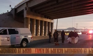 Rescuers attend to bodies that were hanged on the freeway to La Paz, Baja California Sur, Mexico on Wednesday.