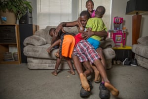 Jaron McNealy, 28, with his children at his mother's home.