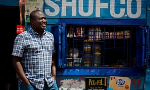 Kennedy Odede, a social entrepreneur, who is co-founder of Shining Hope for Communities, (SHOFCO) a non-profit organisation that tackles urban poverty and gender inequity in the slums of Nairobi poses for a photograph outside a shop with the orgnaisations name in Kibera Slum, Nairobi, Kenya Monday, April 29, 2019. Kibera is one of the largest slums in Africa and is home to an estimated 500,000 people most of whom live on less than one dollar a day.