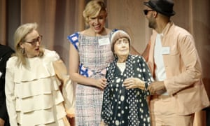 Meryl Streep and Greta Gerwig with JR (right) holding a cardboard cut-out of Agnes Varda at the 90th Academy Awards nominees lunch.