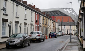 Anfield's new £144m main stand towers above Balfour Street in one of Britain's most deprived areas.