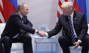 Vladimir Putin and Donald Trump shake hands during a bilateral meeting on the sidelines of the G20 summit in Hamburg Friday.