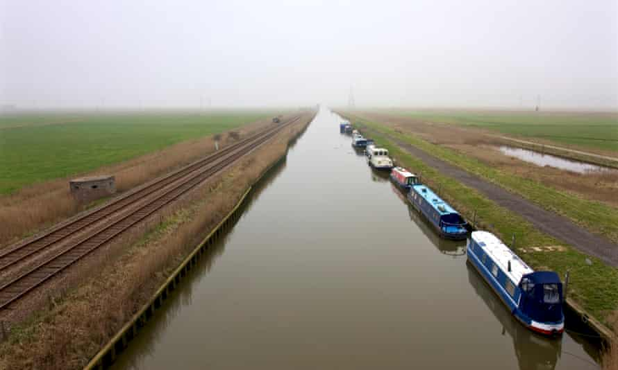 Waterway, disappearing to horizon, with boats