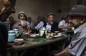 Men talk in a teahouse