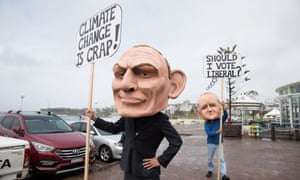 GetUp protesters outside a Wentworth byelection forum in Bondi on Monday. Tony Abbott wants Malcolm Turnbull to be more explicit in his support for Liberal candidate Dave Sharma.