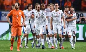 Czech Republic players react after their third, an og by Robin Van Persie.