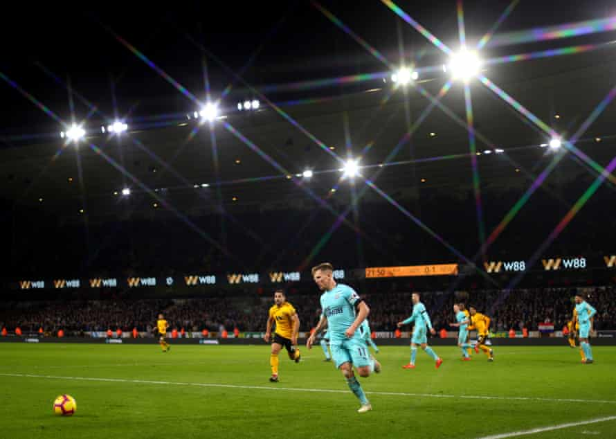 Matt Ritchie in action under the Molineux lights.