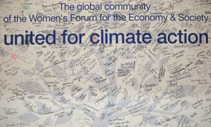 Handwritten messages adorn a wall at the UN climate summit in Paris