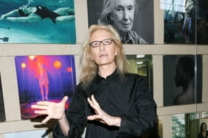 Annie Leibovitz stands in front of her work at the exhibition Women: New Portraits.