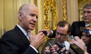 Joe Biden speaks with reporters following the cloture vote on the 21st Century Cures Act in Washington Wednesday.